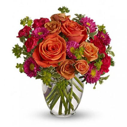 Light orange roses, orange spray roses, and matsumoto asters, hot pink miniature carnations lovely g