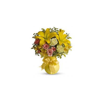 yellow assortment of lilies, roses, alstroemeria and assorted greens are presented in a lovely yello