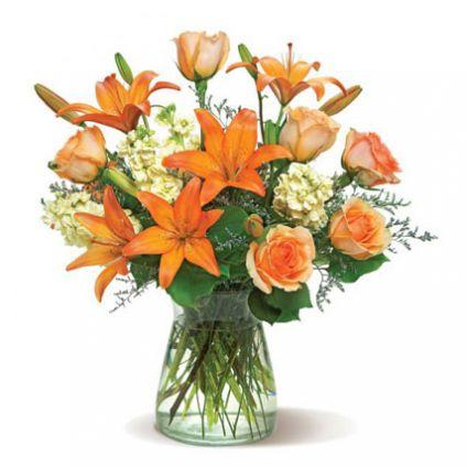 6 yellow stock, 6 peach roses, 6 orange Asiatic lilies, 4 stems lemon leaves, 4 stems misty blue, bu