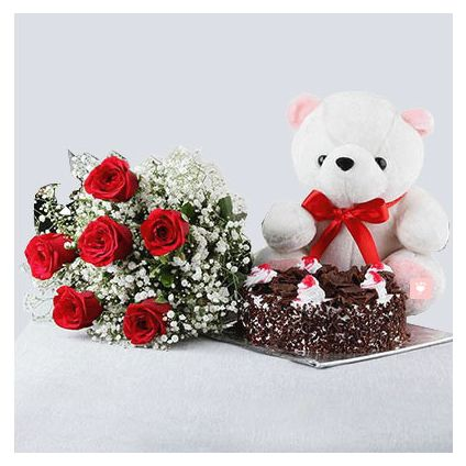 10 Red Roses and Heart Shaped Black Forest Cake with a Teddy Bear