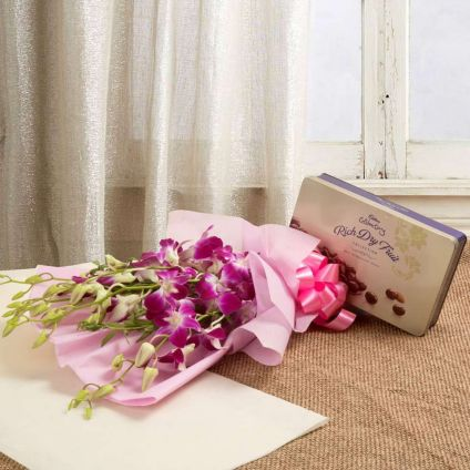 Purple orchids with celebration pack