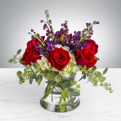 Roses and orchid in vase
